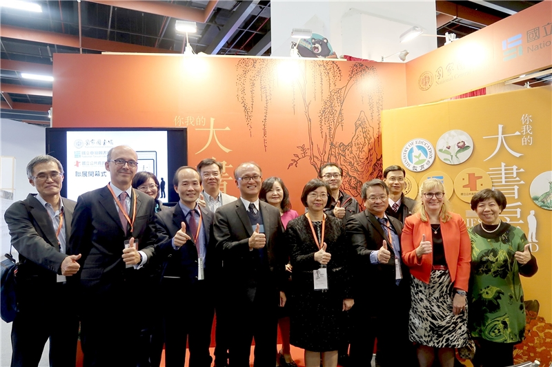"""All dignitaries attending the opening ceremonies posed in front of the """"Libraries The Wonderland"""