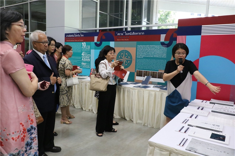 NCL's Editor explains the exhibition for the guests.